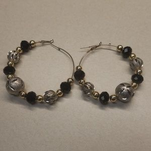 Big hoop earings with very decorative beads